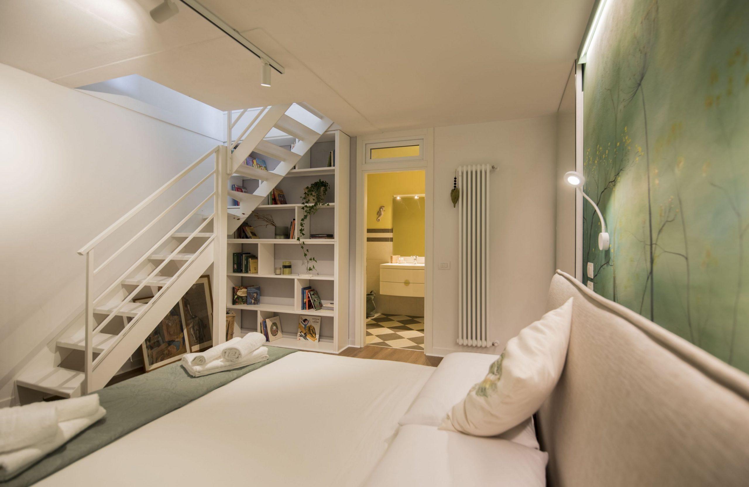 interior design di una camera matrimoniale con bagno